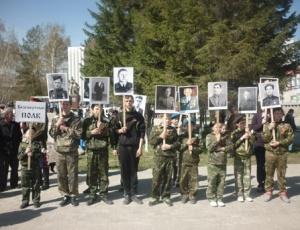 Искитимский «БезсмѢртный полкъ» пополнился портретами местных героев